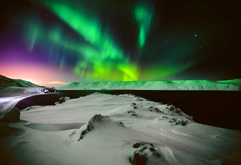 Northern lights in Iceland in December over looking a lake